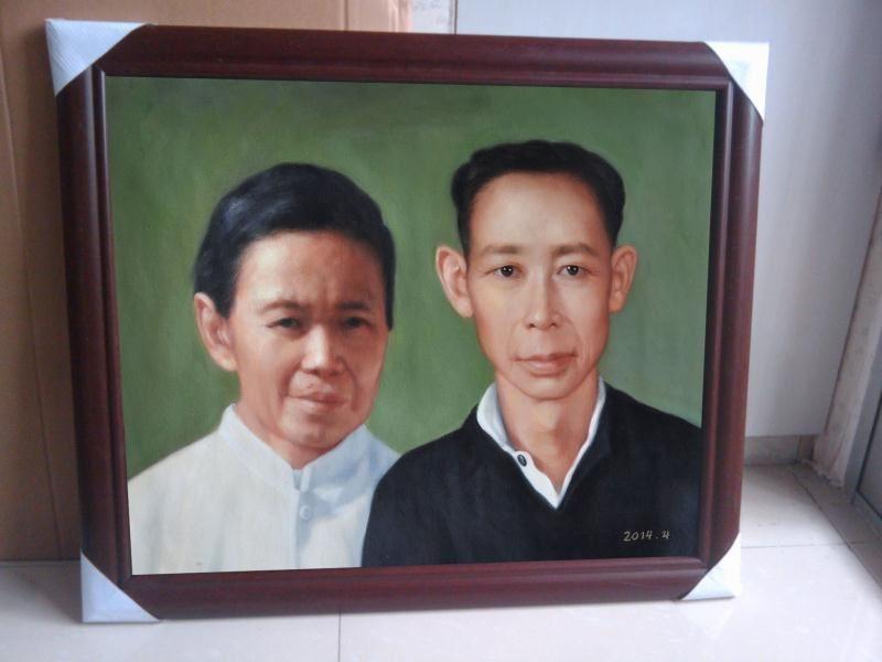 配好高档咖啡色画框的肖像油画